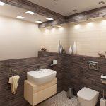 Стените в тоалетната за гости са комбинация от стенни плочи с дървесен ефект и млечно бежово - колекции на ROCA
