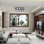 Окачен таван с ефектно осветително тяло и бели мебели