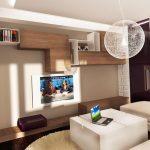 Мебелите в дневната са основно в  бяло, а нотка уют внасят и повърхностите с дървесен натюрел