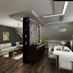 Стената, разделяща къта за отдих от трапезарията, е облицована и от двете страни с изкуствен камък