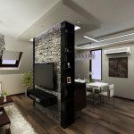 Стената зад TV-къта е облицована с декоративен камък