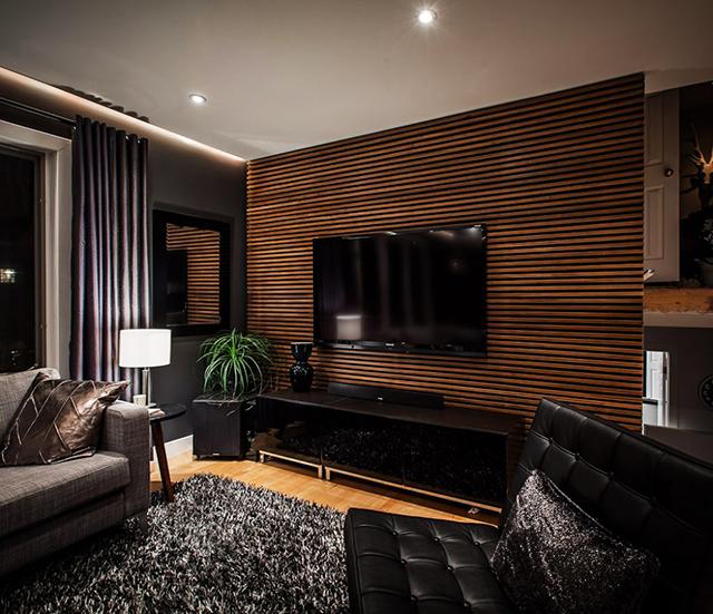 Декорация с дърво зад телевизора