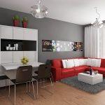 Червеният диван се откроява на сивите стени